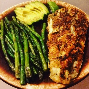 Almond flour crusted halibut fried in coconut oil with a side of asparagus and avocado